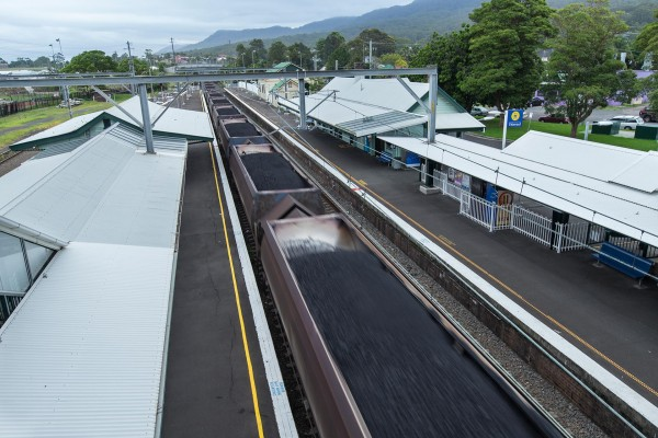 Freight train travelling through Thirroul station