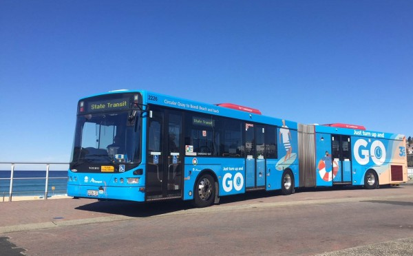 333 Bondi Link bus decorated with images of surfers and the beach
