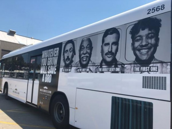 Artwork on the side of a bus showing men with various moustaches.