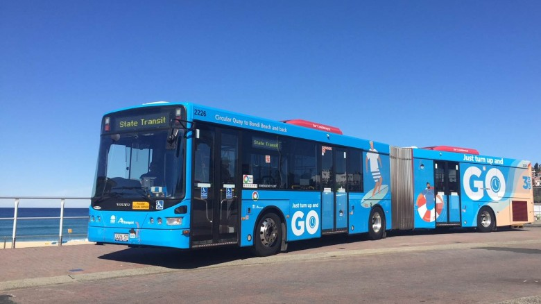 333 bus decorates in blue with images of waves and surf