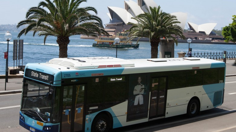 A State Transit Bus, with the Sydney Opera House in the background.