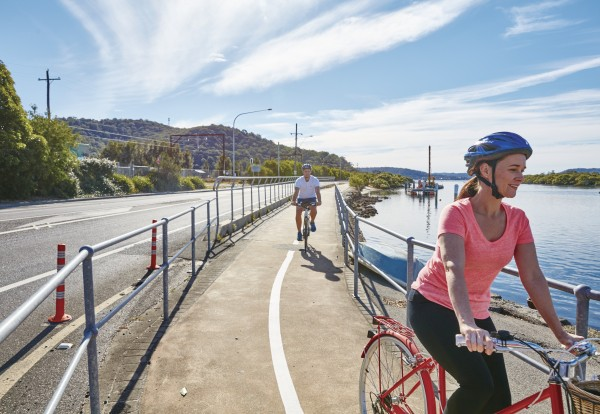 Photo of a family cycling along the waterfront