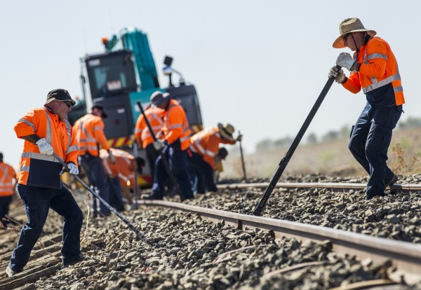 Workers doing trackwork on a country rail network